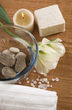 Welness products. Spa. welness products - bar of soap, towel, water, stones, candles and flower stock photography