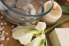 Welness products. Spa. welness products - bar of soap, towel, water, stones, candles and flower royalty free stock photo