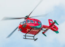 Welsh air ambulance helicopter. Helimed59, Welsh air ambulance red helicopter based in Wales flying.  In operation here on June 18th 2014 after collecting and Stock Photography