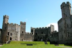 Welsh Castle - Caernarfon. View of one of the great castles in Wales - this one is the famous Caernarfon Royalty Free Stock Images