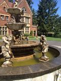 Welsh castle and courtyard fountain Royalty Free Stock Photos