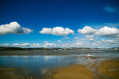 Welsh coast lone boat cloudscape Royalty Free Stock Photography