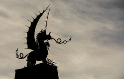 Welsh Dragon statue in Silhouette, against a wintry sky Stock Photos