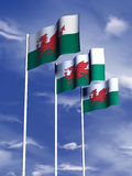 Welsh flag. The flag of Wales flies in front of a blue sky vector illustration