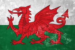 Welsh Flag. Wales - Welsh Flag on Old Grunge Texture Background royalty free stock photos