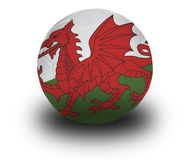 Welsh Football. Football (soccer ball) covered with the Welsh flag with shadow on a white background.  Clipping path included Stock Photography