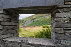 Welsh hillside through ruined window frame Royalty Free Stock Images