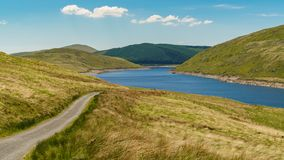 Nant-y-Moch Reservoir, Wales, UK. Welsh landscape and a country road at the Nant-y-Moch Reservoir, Ceredigion, Dyfed, Wales, UK Royalty Free Stock Photos