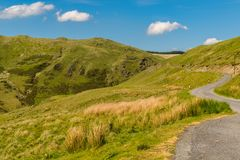 Welsh landscape near Tal-y-bont, UK. Welsh landscape and a country road near the Tal-y-bont, Ceredigion, Dyfed, Wales, UK Stock Image