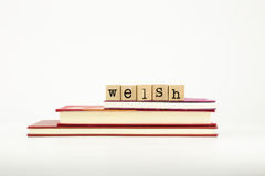 Welsh language word on wood stamps and books Stock Images