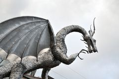 Welsh metal dragon sculpture, architecture. The sculpture is in Ebbw Vale in Wales, UK royalty free stock photography