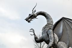 Welsh metal dragon sculpture, architecture. The sculpture is in Ebbw Vale in Wales, UK stock photos