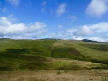 Welsh mountain landscape. Lush green rolling mountain on top of the Rhondda valley south wales uk with blue sky and white clouds o Stock Images