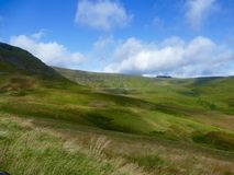 Welsh mountain landscape. Lush green rolling mountain with blue sky and white clouds over the Welsh hills Royalty Free Stock Image