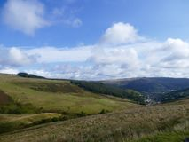 Welsh mountain landscape. Lush green rolling mountain with blue sky and white clouds over the Welsh hills Royalty Free Stock Photos