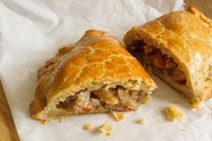 Welsh Oggie or Pasty. Welsh Oggie a regional delicacy from Wales of lamb leeks and vegetables baked in a short crust pastry case similar to a Cornish pasty Stock Photo