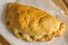 Welsh Oggie or Pasty. Welsh Oggie a regional delicacy from Wales of lamb leeks and vegetables baked in a short crust pastry case similar to a Cornish pasty Stock Photos
