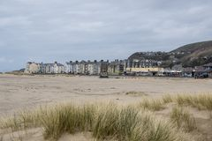 Welsh Seaside Town. A view looking at Barmouth from the beach on a bright day in April 2018 royalty free stock photos