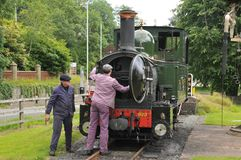 Welshpool & Llanfair Light Railway Steam Engine. Preserved former Great Western Narrow Gauge Railway Steam Engine Number 823 Countess receives attention before royalty free stock images