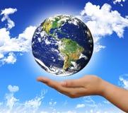 Welt auf der Hand Stockfoto