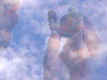 Welt in Ihrer Hand Stockbild