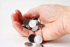 Welth. Metal coins in human hand stock images