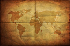 Weltkarte auf altes grunge faltendem Papier Lizenzfreie Stockfotos