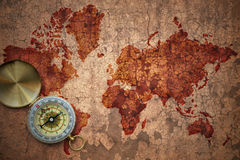 Weltkarte auf einem gebrochenen Papier der alten Weinlese Lizenzfreie Stockfotografie