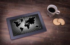 Weltkarte auf einer Tablette Stockbilder
