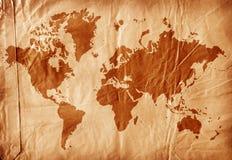 Weltkarte auf gealtertem Papier Stockbilder