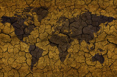 Weltkarte auf gebrochenem beige Hintergrund Lizenzfreie Stockfotos
