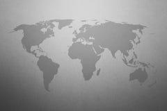 Weltkarte auf grauem Papierbeschaffenheitshintergrund Stockfotos