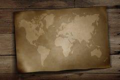 Weltkarte auf hölzernem Stockfoto