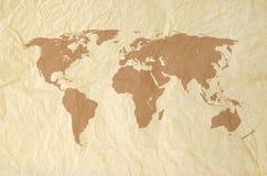 Weltkarte auf Weinlese yallow Papierbeschaffenheit Stockbilder
