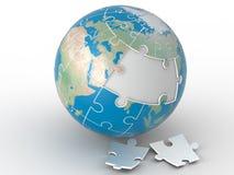 Weltlaubsäge, Weltpuzzlespiel auf weißem Hintergrund Lizenzfreies Stockfoto