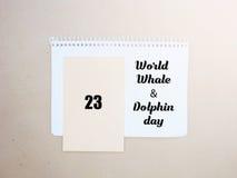 Weltwal-Delphintagesemblem 23. Juli Stockfotos