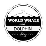 Weltwal-Delphintagesemblem lokalisierte Vektorillustrationsschwarztext auf weißem Hintergrund Stockfoto