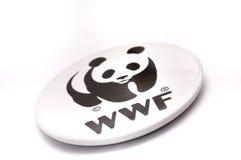 Weltweites Kapital für Natur Pin--Zurückknopf-Ausweis Stockbild