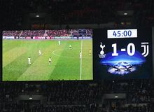 Wembley Scoreboard show final score. Players pictured during the UEFA Champions League Round of 16 game between Tottenham Hotspur and Juventus Torino held on Royalty Free Stock Images