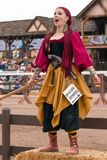 Jousting Event Renaissance Wench. A wench at the jousting event welcomes visitors to the Arizona Renaissance Festival Royalty Free Stock Photos