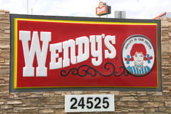 Wendy`s Fast Food Restaurant sign. Valencia, CA - July 24, 2017: Close up on Wendys fast food sign. Wendy`s is the world`s third largest hamburger fast food Stock Photo