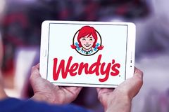 Wendys fast food logo. Logo of wendys fast food restaurants on samsung tablet Royalty Free Stock Photos