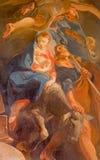 Wenen - Heilige Familievlucht aan de verf van Egypte van zijaltaar in barokke Jezuïetenkerk stock afbeelding