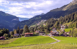 Wengen in the swiss Alps. Wengen  in the swiss Alps, in a valley with rural houses, in the background are mountains on a cloudy day Royalty Free Stock Photography