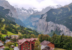 Wengen in the swiss Alps. Wengen  in the swiss Alps, in a valley with rural houses, in the background are mountains on a cloudy day Royalty Free Stock Photos