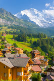 Wengen village in Alps. View on Wengen village and Alps mountains in Switzerland Royalty Free Stock Photos
