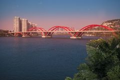 Liuzhou City,China. Wenhui bridge is a red concrete arch bridge like a rainbow Royalty Free Stock Image