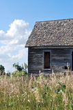 Wenig Haus auf dem Kansas-Grasland Stockbild
