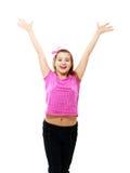Mädchen steht und hält Hände hoch stockbilder