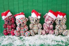 Wenig teddybears mit Sankt-Hüten Stockfoto